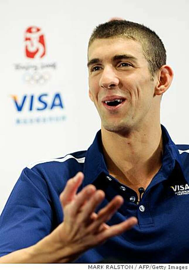 US swimmer Michael Phelps gives a press conference during a promotional event at the end of the Olympic swimming competition in Beijing on August 18, 2008, as part of the 2008 Beijing Olympic Games.  The 23-year-old Phelps won an historic eighth gold medal, surging past yet another Olympic milestone as the United States clinched the men's 4x100m medley relay in world record time. With the victory, Phelps overtook compatriot Mark Spitz, whose seven swimming golds at Munich in 1972 were the most at a single Games.     AFP PHOTO/Mark RALSTON (Photo credit should read MARK RALSTON/AFP/Getty Images) Photo: MARK RALSTON, AFP/Getty Images