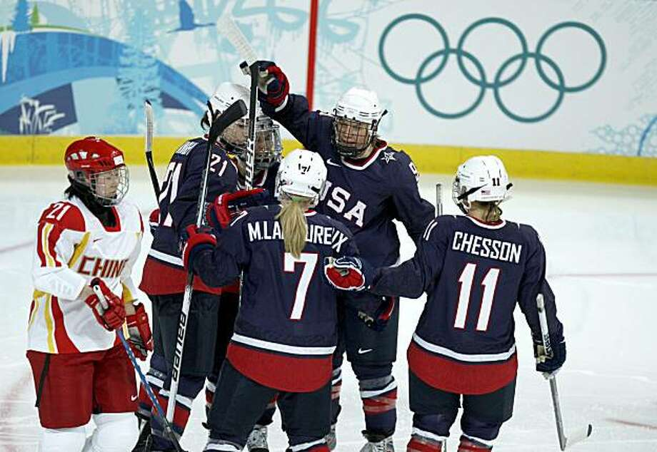 USA players celebrate Molly Engstrom's goal against China in the second period of the 2010 Winter Olympics. The United States defeated China, 12-1, at the UBC Thunderbird Arena in Vancouver, British Columbia, Sunday, February 14, 2010. (Nuccio DiNuzzo/Chicago Tribune/MCT) Photo: Nuccio DiNuzzo, MCT