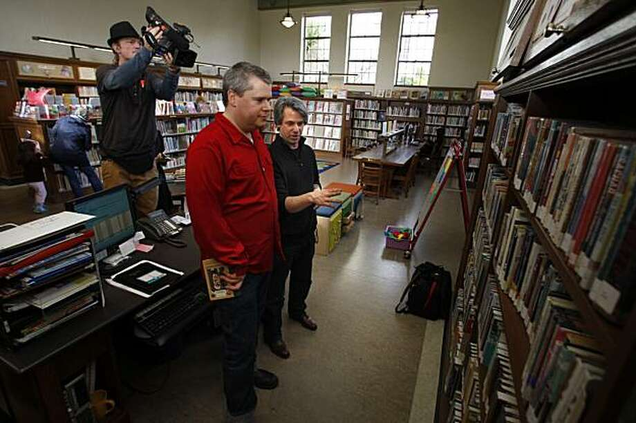 Tom Corwin (right) talks with author Daniel Handler (middle), aka Lemony Snicket, at Handler's childhood library, the West Portal branch in San Francisco, Ca. on Thursday, January 28, 2010.  Corwin drives around the country, letting authors take the wheel to talk about the importance of books and libraries.  He documents their interviews with Jim Dziura (cq) behind. Photo: Liz Hafalia, The Chronicle