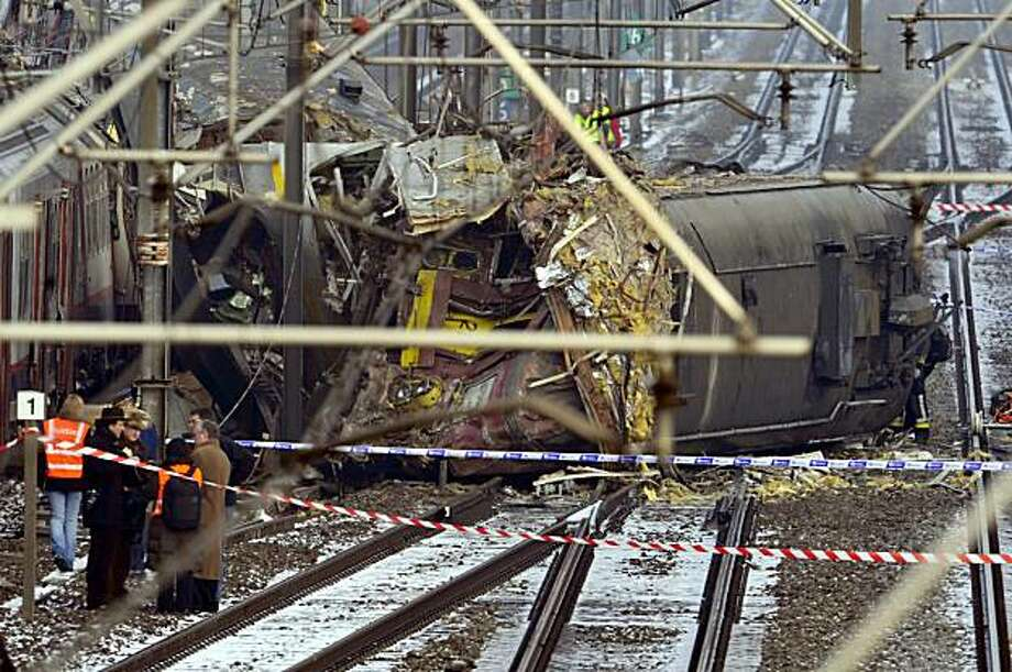 The area where two passenger trains which collided this morning on February 15, 2010, in Buizingen station, in Halle is cordoned off. 18 people are confirmed dead and 55 injured. Photo: Eric Vidal, AFP/Getty Images