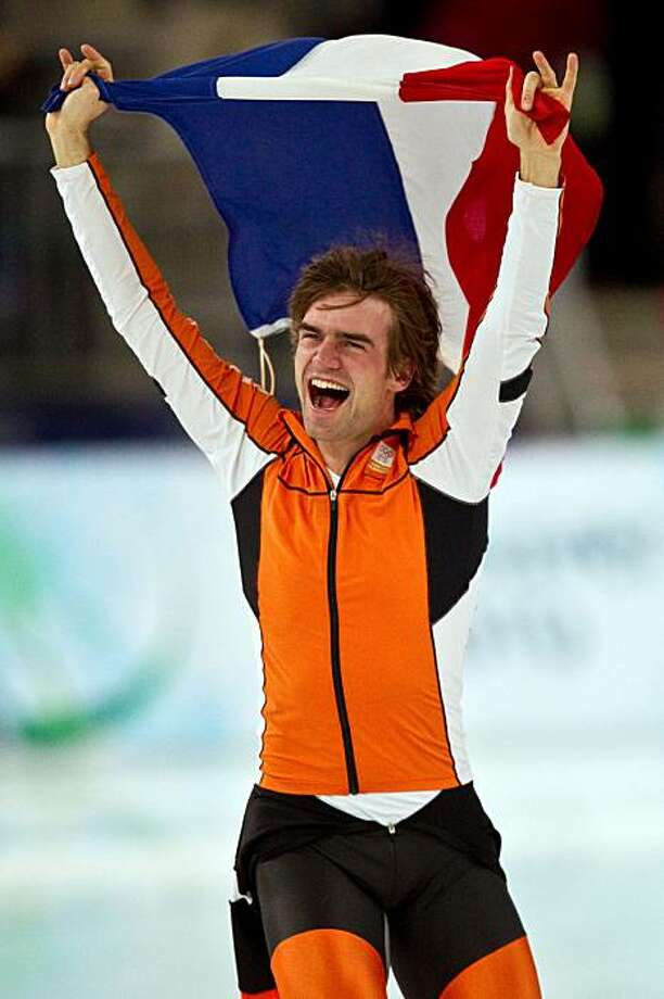 Mark Tueter of the Netherlands celebrates after winning the men's 1500 meter speed skating at the 2010 Winter Olympics on Saturday, Feb. 20, 2010, in Richmond. ( Smiley N. Pool / Houston Chronicle) Photo: Smiley N. Pool, Chronicle Olympic Bureau
