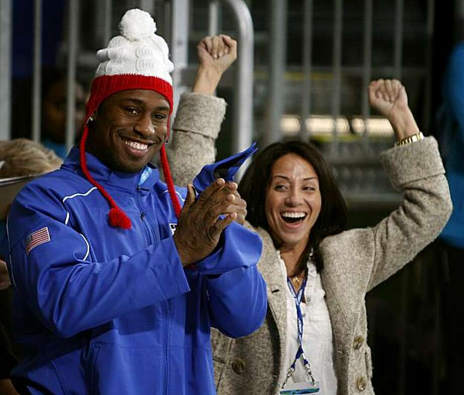 San Francisco 49ers tight end and honorary captain of the United States curling team Vernon Davis and his assistant Sasha Taylor cheer after the Americans beat France, 4-3, at the Winter Olympic Games in Vancouver, British Columbia, on Friday, Feb. 19, 2010. Paul Chinn/Chronicle Olympic Bureau Photo: Paul Chinn, The Chronicle