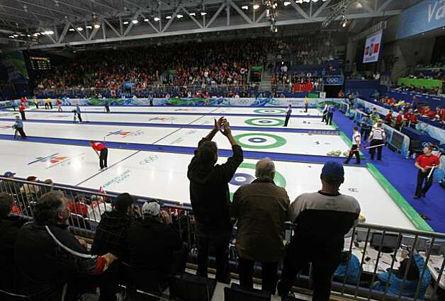 Curling fans watch four matches, including the United States vs. France, at the Winter Olympic Games in Vancouver, British Columbia, on Friday, Feb. 19, 2010. The United States beat France 4-3. Photo: Paul Chinn, The Chronicle