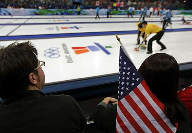 Isaac Peterson and Jen Brown from Seattle, Wash. watch four curling matches, including the United States vs. France, at the Winter Olympic Games in Vancouver, British Columbia, on Friday, Feb. 19, 2010. The United States beat France 4-3. Photo: Paul Chinn, The Chronicle