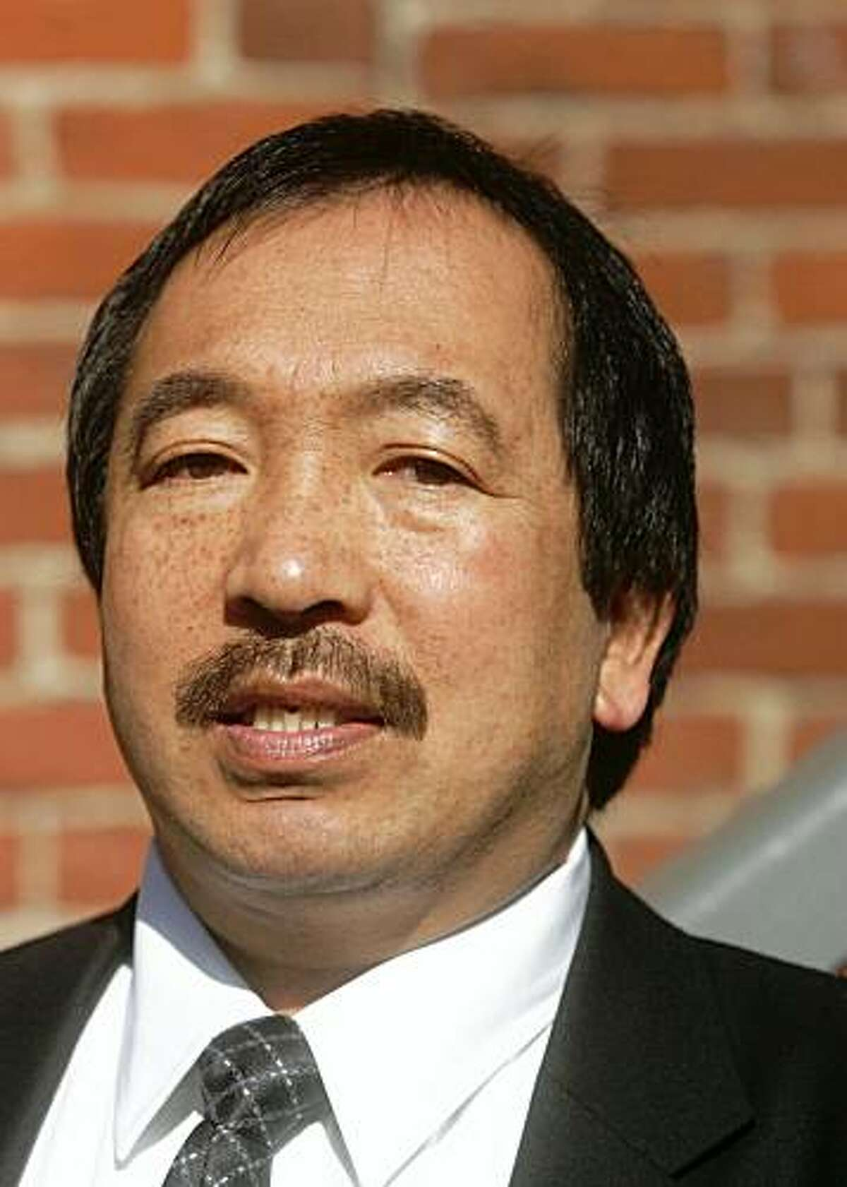 Irwin Lum, president of the workers union Local 250A.