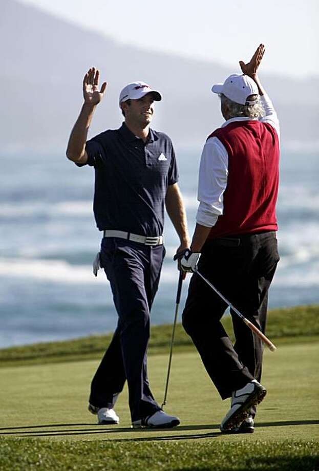 Dustin Johnson high fives his amateur playing partner, Joe Rice, after his one-shot victory with a birdie on the 18th hole at the AT&T National Pro-Am on Sunday in Pebble Beach. Photo: Michael Macor, The Chronicle
