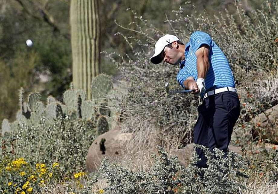 Paul Casey, of England, hits his tee shot on the par three 12th hole his second round 5 and 4 victory over Mike Weir at the second round of the Accenture Match Play Championship golf tournament Thursday, Feb. 18, 2010, in Marana, Ariz. Photo: Matt York, AP