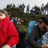Kerry Murayama and her daughter Kelcie Murayama, of Discovery Bay, Calif., laugh as they discuss motivations for coming to the Mavericks Surf Contest on Saturday Feb. 13, 2009 in Pillar Point, Calif.