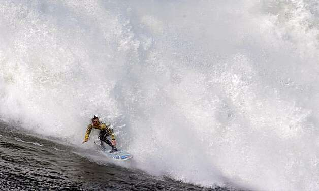 Kenny Collins rides a wave in the sixth heat of the Mavericks Surf Contest. Surfers from around the globe braved the 50-foot-high swells at Mavericks Surf Contest in Half Moon Bay, Calif., on Saturday, February 13, 2010. Chris Bertish of South Africa was selected the winner. Photo: Carlos Avila Gonzalez, The Chronicle