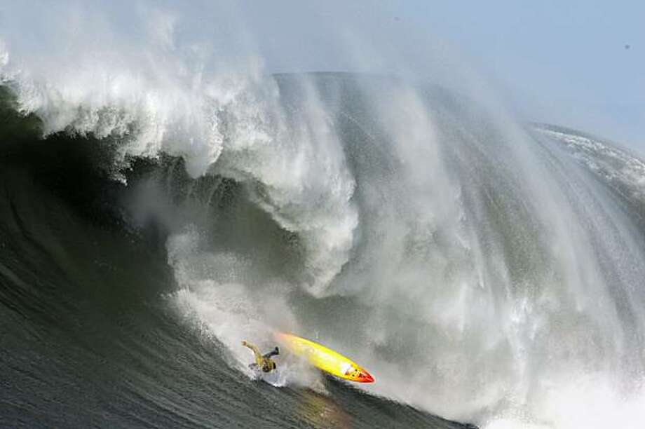 "Darryl ""Flea"" Virostko wipes out in the fifth heat of the Mavericks Surf Contest. Surfers from around the globe braved the 50-foot-high swells at Mavericks Surf Contest in Half Moon Bay, Calif., on Saturday, February 13, 2010. Chris Bertish of South Africa was selected the winner. Photo: Carlos Avila Gonzalez, The Chronicle"