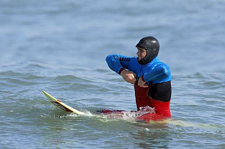 Ben Andrews dons his blue jersey to begin the fourth heat. Surfers from around the globe braved the 50-foot-high swells at Mavericks Surf Contest in Half Moon Bay, Calif., on Saturday, February 13, 2010. Chris Bertish of South Africa was selected the winner. Photo: Carlos Avila Gonzalez, The Chronicle