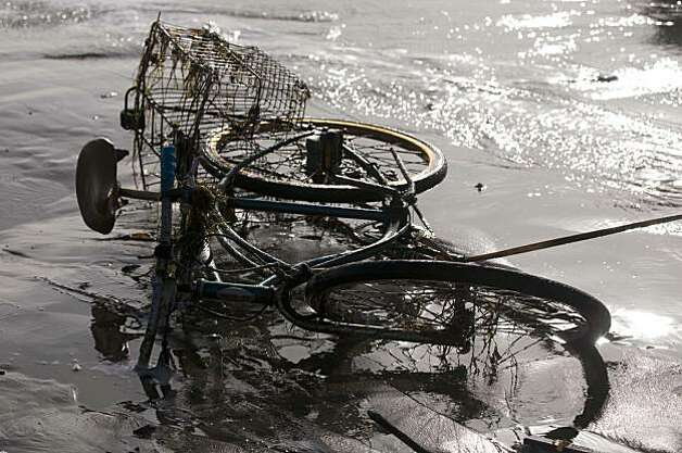 A mangled bike was left behind after a rogue wave washed over the beach during the Mavericks Surfing Contest on Saturday Feb. 13, 2010 in Pillar Point, Calif.  Several injuries where reported. All non-emergency personal was evacuated from the beach. Photo: Chad Ziemendorf, For The Chronicle