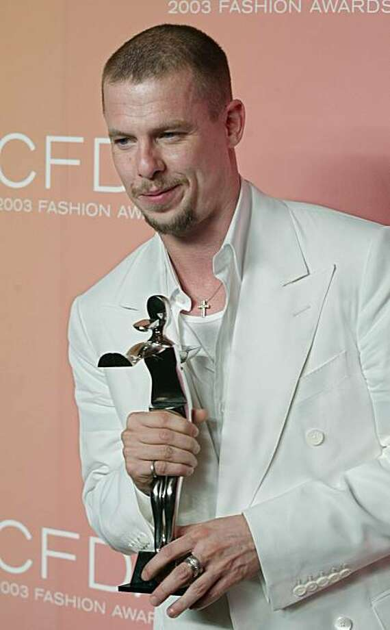 FILE - This Monday, June 2, 2003 file photo shows Alexander McQueen posing for photographers after winning the International Award at the 2003 Council of Fashion Design Awards held in New York. Fashion designer Alexander McQueen was found hanging in the wardrobe of his London apartment last week with a note left nearby, a British coroner's official told an inquest Wednesday Feb. 17, 2010. No details of the note were released by the coroner's office, which is charged with formally identifying the circumstances of the designer's death. Photo: Stuart Ramson, File, AP