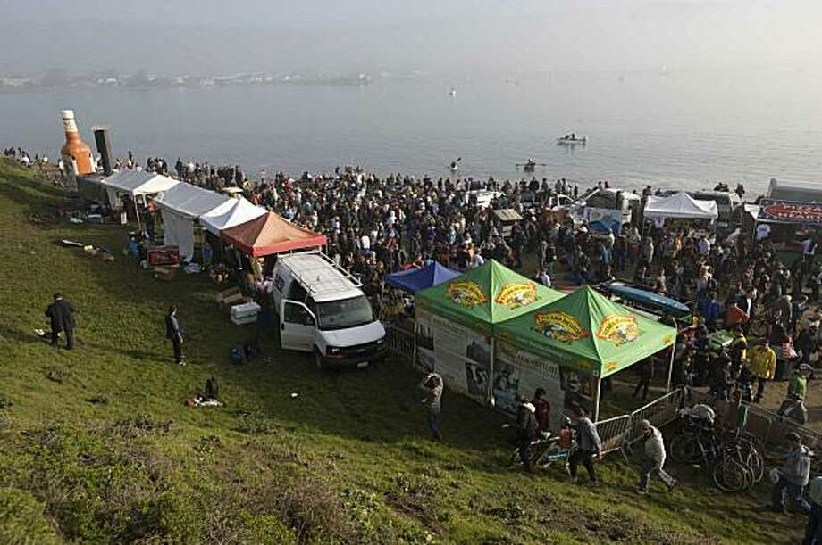 A crowd stands around a set of rogue waves washes over the beach during the Mavericks Surfing Contest on Saturday Feb. 13, 2010 in Pillar Point, Calif.  Several injuries where reported. All non-emergency personal was evacuated from the beach. Photo: Chad Ziemendorf, For The Chronicle
