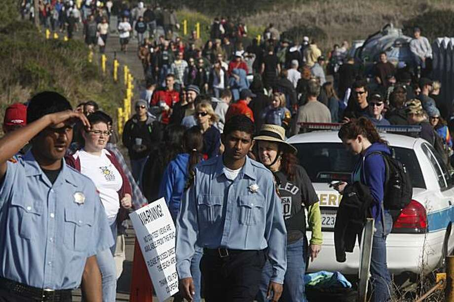 San Mateo County Explorers help keep out of the beach area after rogue waves force authorities to evacuate people from the contest area of the Mavericks Surf Contest on Saturday Feb. 13, 2010 in Pillar Point, Calif. Photo: Mike Kepka, The Chronicle