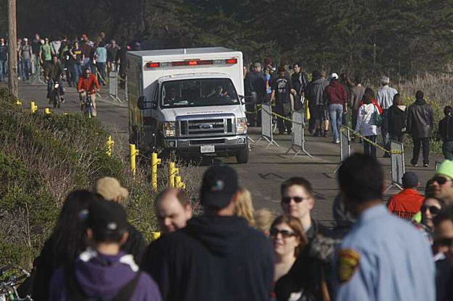 An ambulance heads for the beach after rogue waves washed over the beach at the Mavericks Surf Contest on Saturday Feb. 13, 2009 in Pillar Point, Calif. Photo: Mike Kepka, The Chronicle