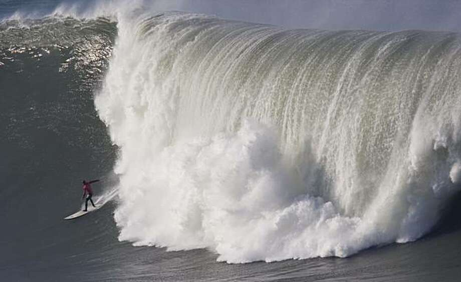 An unidentified surfer competes in the first round heats of the Mavericks Surf Contest in Half Moon Bay on Saturday. Photo: Adam Lau, The Chronicle