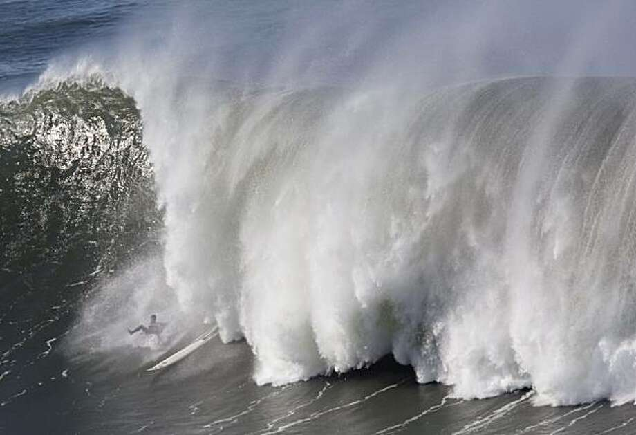 Tim West loses his footing during the first round heats of the Mavericks Surf Contest in Half Moon Bay on Saturday. Photo: Adam Lau, The Chronicle