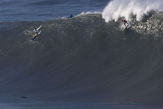An unidentified surfer gets to a wave before his competitors in the first round heats of the Mavericks Surf Contest in Half Moon Bay on Saturday. Photo: Adam Lau, The Chronicle