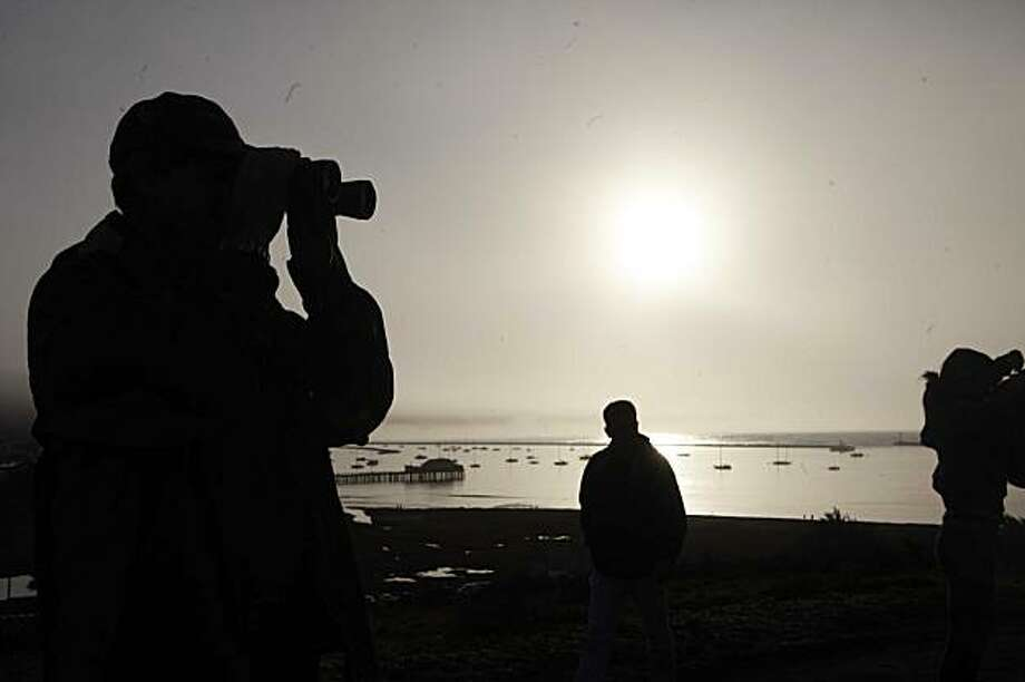 As the sun rises, David Ewell, of Campbell, Calif,  watches the waves at the Mavericks Surf Contest on Saturday Feb. 13, 2009 in Pillar Point, Calif. Photo: Mike Kepka, The Chronicle