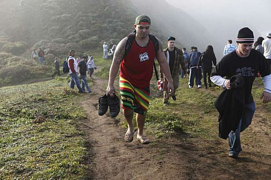 Vance Otake, of Rhonert Park, Calif., hikes up the cliffs to watch the Mavericks Surf Contest on Saturday Feb. 13, 2009 in Pillar Point, Calif. Photo: Mike Kepka, The Chronicle