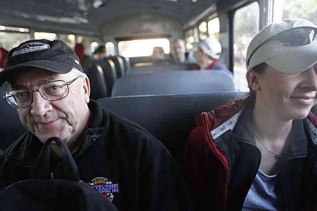 Riding on a shuttle bus, Bill Skolout and his daughter, Alex Skolout  head to the beach to watch their first Mavericks Surf Contest on Saturday Feb. 13, 2009 in Pillar Point, Calif. Photo: Mike Kepka, The Chronicle