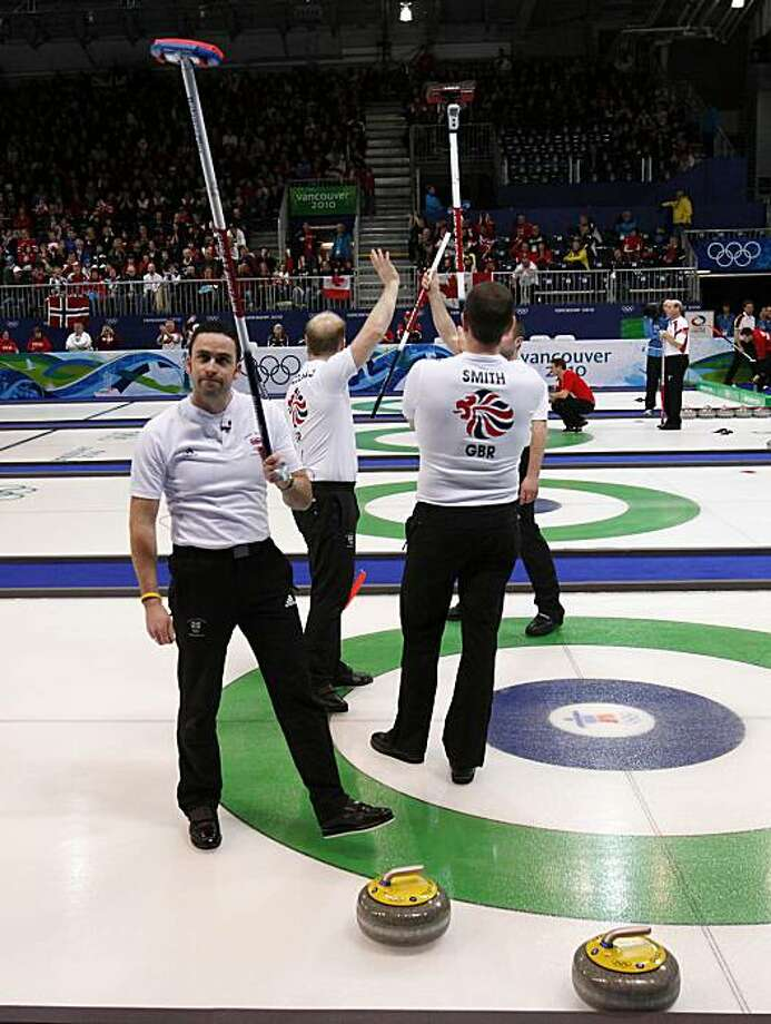 Great Britain skip David Murdoch, left,  Ewan MacDonald, and Pete Smith acknowledge applause after defeating the U.S. in a men's curling at the Vancouver 2010 Olympics in Vancouver, British Columbia, Sunday, Feb. 21, 2010. Photo: Robert F. Bukaty, AP