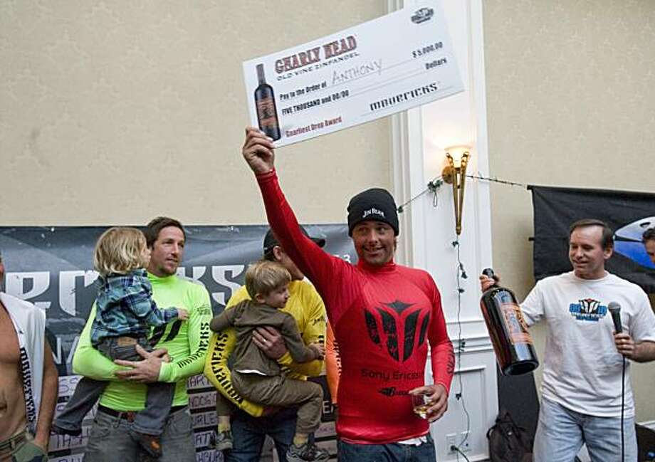 Anthony Tashnick, Santa Cruz native and past Mavericks winner, holds up his check after winning the heaviest wipeout award at the 2009/2010 Mavericks Surf Contest in Half Moon Bay, Calif. on Saturday, Feb. 13, 2010. Photo: Adam Lau, The Chronicle