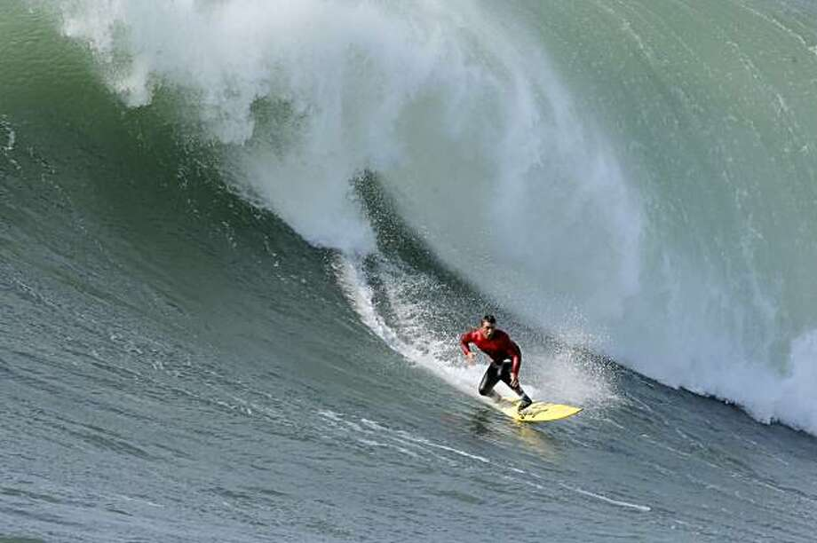 Anthony Tashnick rides a wave in the final heat of the Mavericks Surf Contest. Surfers from around the globe braved the 50-foot-high swells at Mavericks Surf Contest in Half Moon Bay, Calif., on Saturday, February 13, 2010. Chris Bertish of South Africa was selected the winner. Photo: Carlos Avila Gonzalez, The Chronicle
