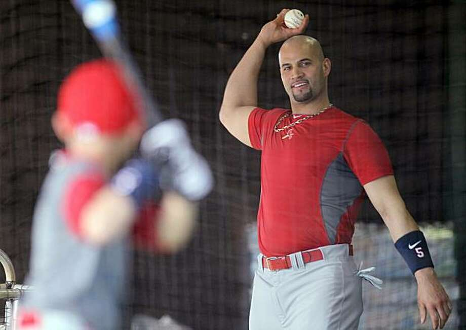 St. Louis Cardinals first baseman Albert Pujols throws batting practice to his son, A. J., in the covered batting cage during spring training at Roger Dean Stadium in Jupiter, Florida, Sunday, February 21, 2010. (Chris Lee/St. Louis Post-Dispatch/MCT) Photo: Chris Lee, MCT