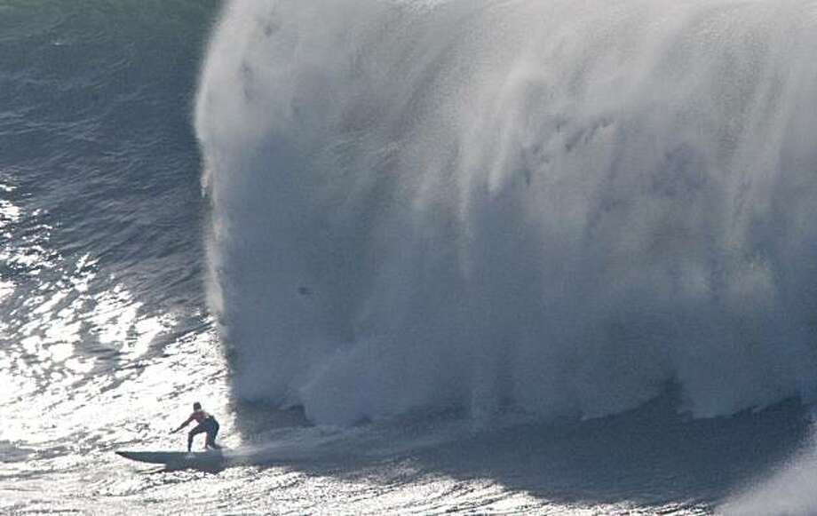 A wall of water catches up to a surfer during the finals of the Mavericks Surf Contest in Half Moon Bay, Calif. on Saturday, Feb. 13, 2010. Photo: Adam Lau, The Chronicle