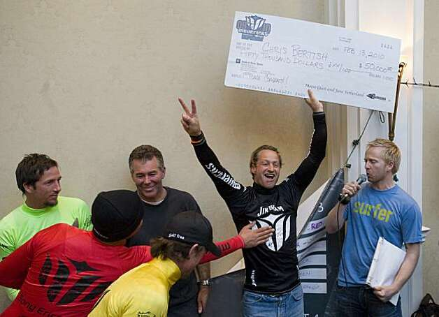 South African surfer Chris Bertish holds up his $50,000 check after winning first place in the Mavericks Surf Contest Surfers in Half Moon Bay, Calif. on Saturday, Feb. 13, 2010. Photo: Adam Lau, The Chronicle