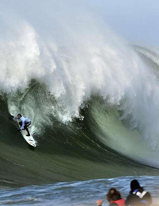 Carlos Burle rides a wave in the sixth heat of the Mavericks Surf Contest. Surfers from around the globe braved the 50-foot-high swells at Mavericks Surf Contest in Half Moon Bay, Calif., on Saturday, February 13, 2010. Chris Bertish of South Africa was selected the winner. Photo: Carlos Avila Gonzalez, The Chronicle
