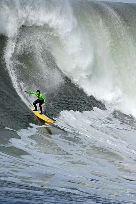 Shawn Rhodes rides a wave in the fourth heat. Surfers from around the globe braved the 50-foot-high swells at Mavericks Surf Contest in Half Moon Bay, Calif., on Saturday, February 13, 2010. Chris Bertish of South Africa was selected the winner. Photo: Carlos Avila Gonzalez, The Chronicle