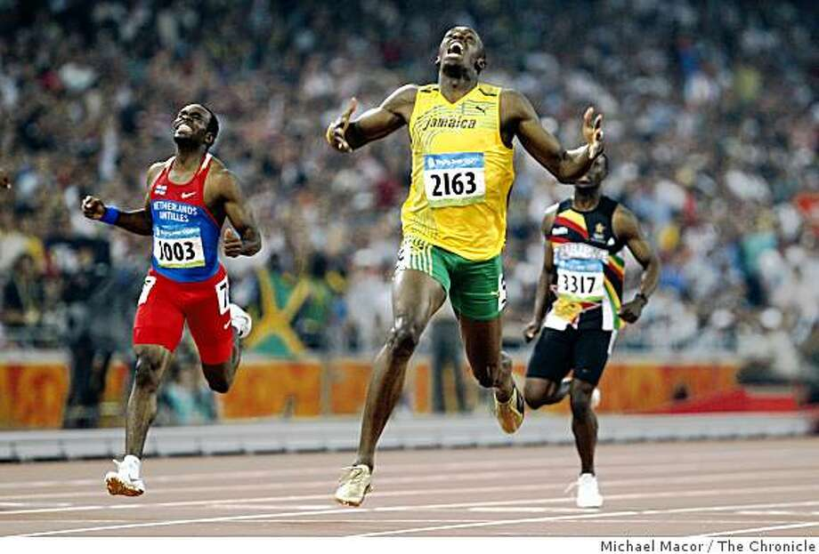 Usain Bolt of Jamaica, took the gold medal in the men's 200m final at the 2008 Olympics in Beijing, China, on Wednesday  Aug. 20, 2008. Churandy Martina, left, of the Netherlands finished with the silver medal. Photo: Michael Macor, The Chronicle