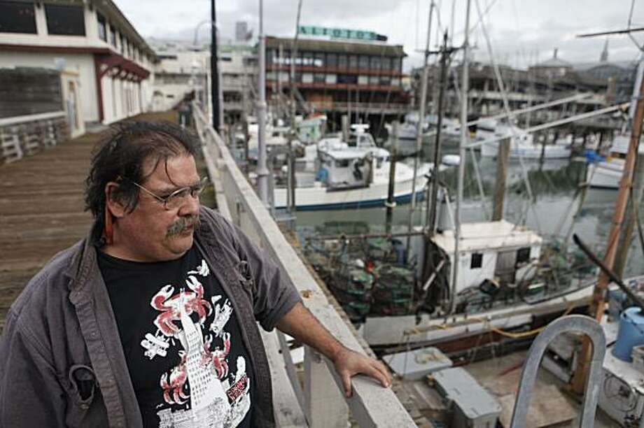 """Larry Collins, president of the San Francisco Crab Boat Association, stands on the dock at Fishermans Wharf on Monday Feb. 08, 2010 in San Francisco, Calif. where dozens of salmon boats and the fisherman who operate them have been sitting still for two years because they are now allowed to fish. """"Salmon fishing is part of San Francisco's history. What would Fisherman's Wharf be without fisherman,"""" said Collins. Photo: Mike Kepka, The Chronicle"""