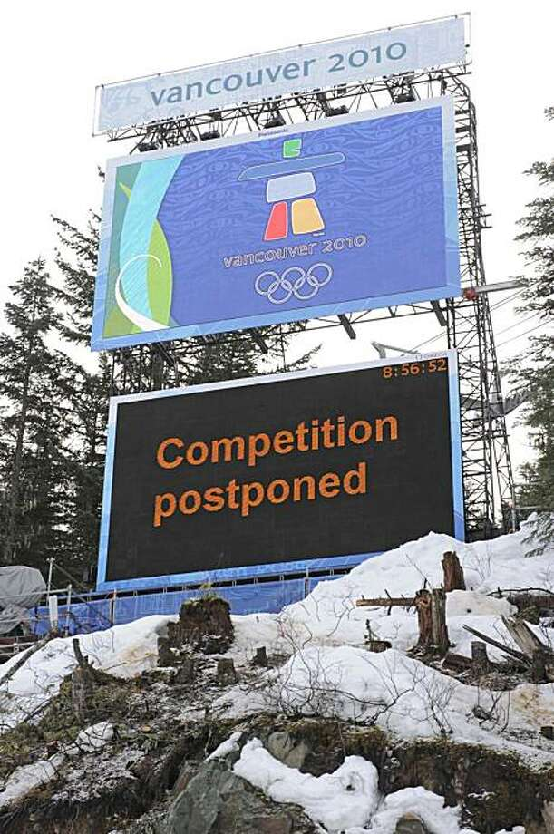 A finish area scoreboard announces the postponement of the Men's downhill due to poor weather conditions at the Vancouver 2010 Olympics in Whistler, British Columbia, Saturday, Feb. 13, 2010. Photo: Gero Breloer, AP