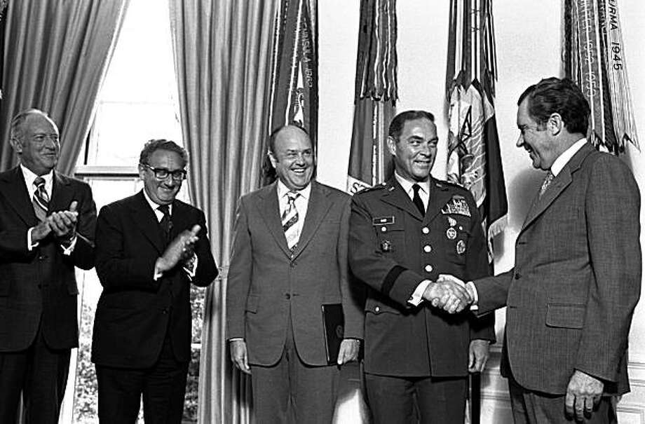 FILE- In this Jan. 4, 1973 file photo, President Nixon, right, congratulates Gen. Alexander Haig after presenting him with the Distinguished Service Medal at the White House. Joining the ceremony, from left, Secretary of State William Rogers, PresidentialAdviser Henry Kissinger, and Secretary of Defense Melvin Laird. Former Secretary of State Alexander Haig, who served Republican presidents and ran for the office himself, has died. The Haig family says he died Saturday Feb. 20, 2010 at Johns Hopkins Hospital in Baltimore from complications associated with an infection. He was 85. Photo: AP