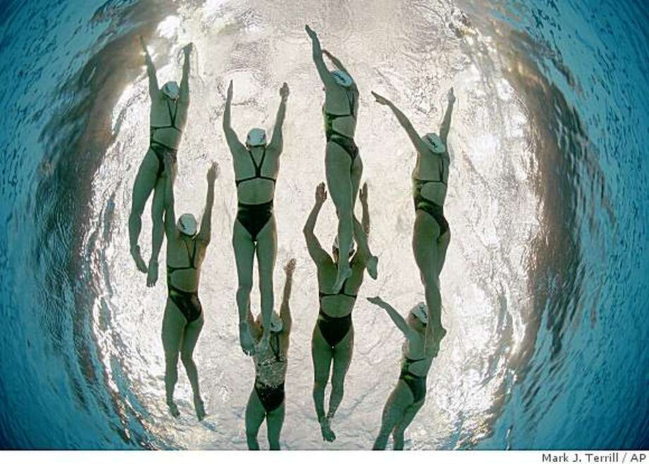 Japan's synchronized swimming team are seen during a training session in the National Aquatics Center at the Beijing 2008 Olympics in Beijing, Thursday, Aug. 7, 2008. (AP Photo/Mark J. Terrill) Photo: Mark J. Terrill, AP
