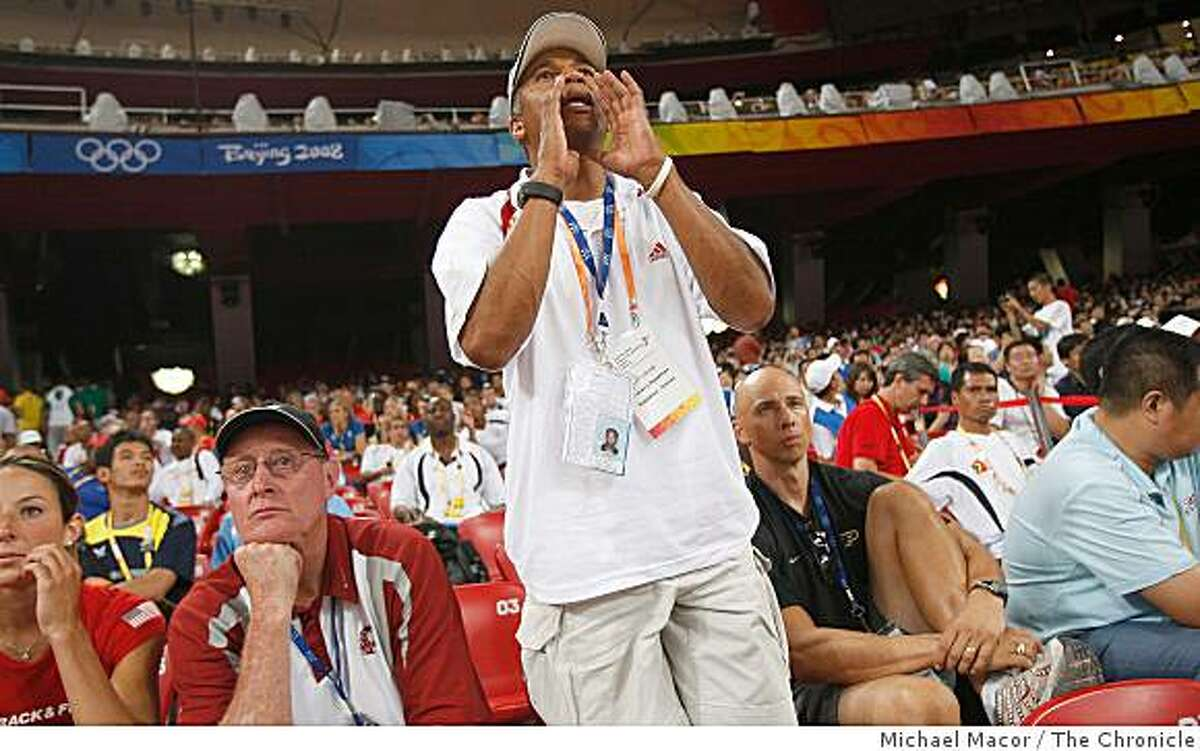 Heptahlon coach Lynn Smith, shouts directions to his heptahlon athlete from the stands during on the opening day of athletics competitions, on Friday Aug. 15, 2008 at the Olympic Games in Beijing, China.