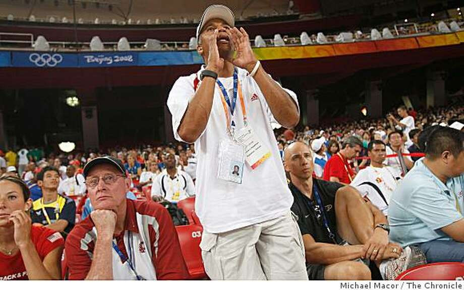 Heptahlon coach Lynn Smith, shouts directions to his heptahlon athlete from the stands during  on the opening day of athletics competitions, on Friday Aug. 15, 2008 at the Olympic Games in Beijing, China. Photo: Michael Macor, The Chronicle
