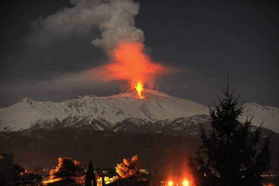 Lava flows during an eruption of Mount Etna volcano, near Catania, Sicily, in the early hours of Thursday. (AP Photo/Carmelo Imbesi) Photo: Carmelo Imbesi, ASSOCIATED PRESS / AP2012