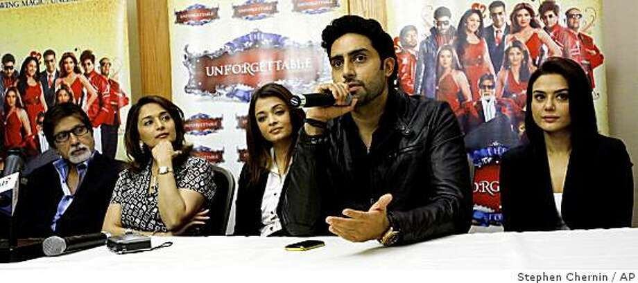 "Bollywood Superstars Abhishek Bachchan, second right, speaks as fellow actors listen during a news conference Thursday, Aug. 14, 2008 in New York. The actors from left are Amitabh Bachchan, Madhuri Dixit, Aishwarya Bachchan, Abhishek Bachchan and Preity Zinta. The actors spoke about ""The Unforgettable Tour"" which is Indian cinema's biggest live show ever and will be performed in cities worldwide. (AP Photo/Stephen Chernin) Photo: Stephen Chernin, AP"