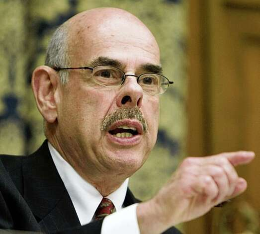 "** FILE **  In this Feb. 26, 2008, file photo, House Oversight and Government Reform Committee Chairman Rep. Henry Waxman, D-Calif., questions witnesses during a hearing of the committee on Capitol Hill in Washington.  Democrats say it's the job of Congress to make sure the Bush administration doesn't violate the Hatch Act, which protects federal employees from involvement in partisan politics and bars the use of most federal facilities for partisan purposes. ""If public officials are making poor decisions, abusing the public trust or wasting taxpayer dollars, they need to know that there's a cop on the beat,"" said Waxman.   (AP Photo/Manuel Balce Ceneta, File) Photo: Manuel Balce Ceneta, AP"