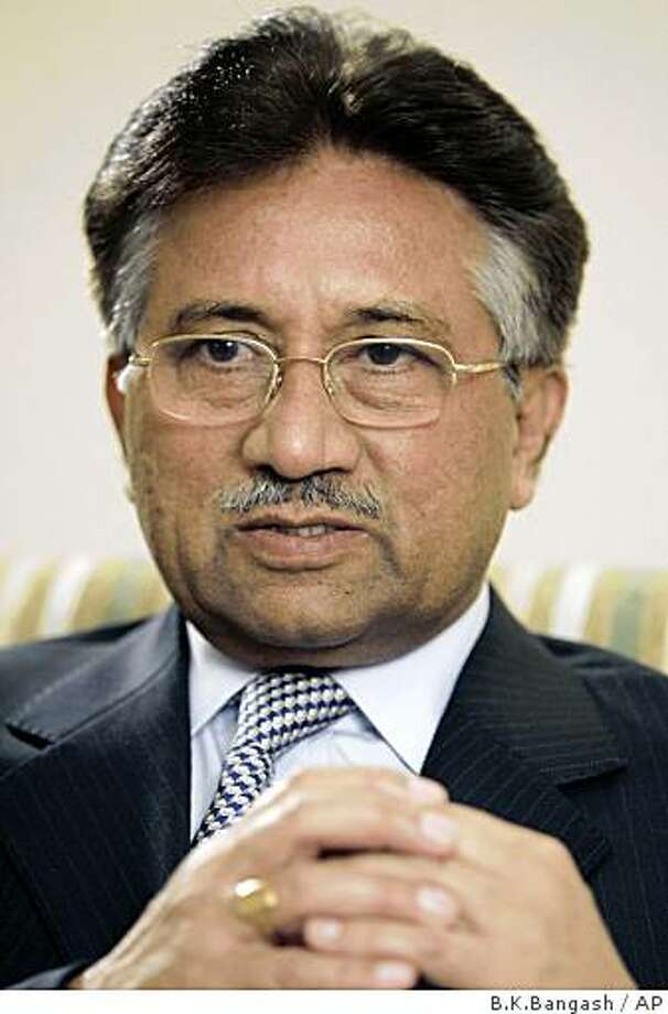 ** FILE **Pakistan's President Gen. Pervez Musharraf talks to reporters in Rawalpindi, Pakistan in this Nov. 14, 2007, file photo. The assassination of Benazir Bhutto has pitched Pakistan into a freefall and raised fears that Islamic extremists are turning the country into another Iraq. Pakistanis blame the deepening turmoil on Musharraf and his U.S.-backed campaign against Islamic extremism, and many believe things will only improve if he resigns as president. (AP Photo/B.K.Bangash) Photo: B.K.Bangash, AP
