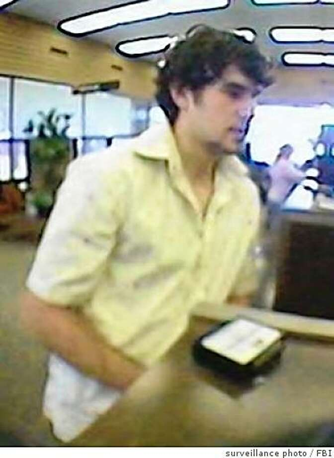 A suspect in four jewelry store robberies in Oregon, California and Nevada is capture here on surveillance camera at a San Francisco bank, where he allegedly opened an account using a stolen drivers license and deposited a bogus check. Photo: Surveillance Photo, FBI