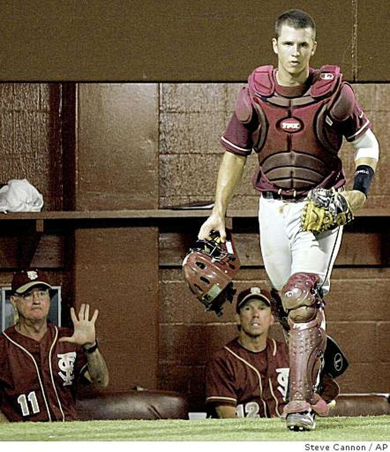 Florida State's Buster Posey heads out of the dugout in the fifth inning against Tulane in the championship baseball game of the Tallahassee Regional on Monday, June 2, 2008 in Tallahassee, Fla. Posey is projected to be one of the top draft picks when the Major League Baseball amateur draft starts Thursday.(AP Photo/Steve Cannon) Photo: Steve Cannon, AP