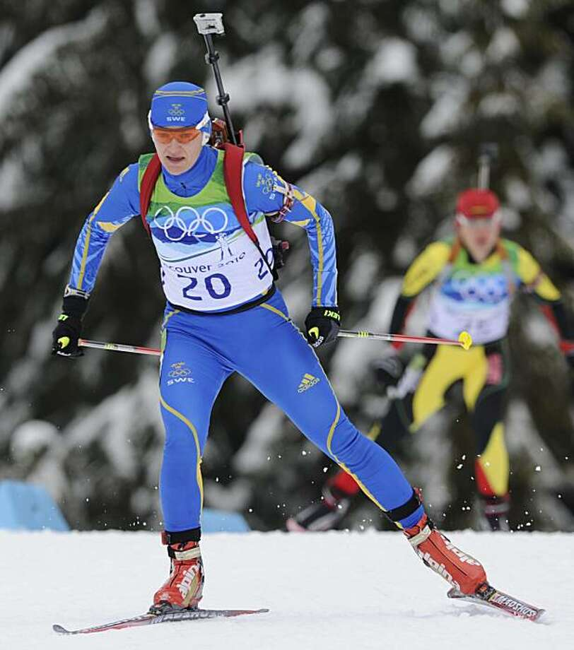 Anna Carin Olofsson-Zidek, left, of Sweden during the women's biathlon 10 km pursuit race at the Vancouver 2010 Olympics in Whistler, British Columbia, Tuesday, Feb. 16, 2010. Photo: Jens Meyer, AP