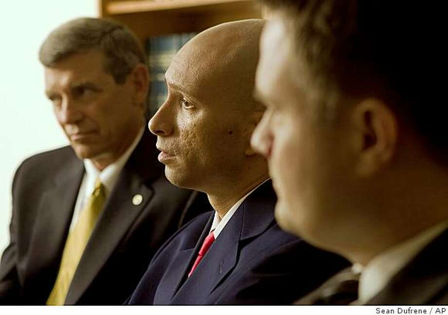 Former Marine Sgt. Jose Luis Nazario Jr., 28, center, from New York, speaks about his impending federal trial, with his attorney's, Douglas L. Applegate, left, and Joseph M. Preis, right, in Irvine, Calif., on Saturday, Aug. 16, 2008.  Nazario faces charges that he shot detainees during the 2004 battle of Fallujah, in Iraq. It's a precedent-setting prosecution with the possibility of a conviction that would expose all former military personnel to prosecution in civilian federal court for actions in combat.  The trial starts on Tuesday, Aug. 19, 2008 in Riverside, Calif.  (AP Photo/Sean Dufrene) Photo: Sean Dufrene, AP