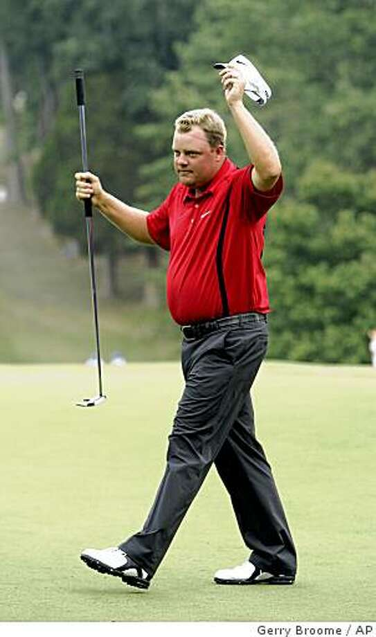 Carl Pettersson reacts on the 18th green after winning during the Wyndham Championship golf tournament in Greensboro, N.C., Sunday, Aug. 17, 2008. Pettersson finished at 21-under par 259. (AP Photo/Gerry Broome) Photo: Gerry Broome, AP